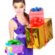 Beautiful woman with make up in dress with gifts — Stock Photo #9237674