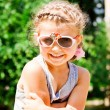 Stock Photo: Beautiful Happy Little Girl outdoor in sunglasses