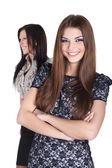 Bella donna sorridente in abito di fronte di altre — Foto Stock