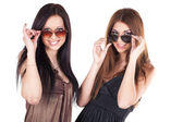Two young beautiful women in sun glasses isolated — Stock Photo