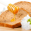 Honey and bread — Stock Photo