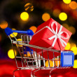 Shopping cart with decorative ball — Stock Photo