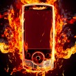 Stock Photo: Burning phone