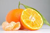 Mandarin on a grey background — Stock Photo