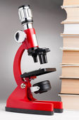 Books and microscope — Stock Photo