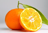 Closeup of a mandarin on a grey background — Stock Photo