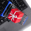Gift on a laptop keyboard — Stock Photo #8081384