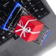 Gift on a laptop keyboard — Stock Photo