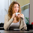 Young woman at cafe — Stock Photo