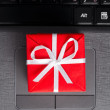 Gift on a laptop keyboard — Stock Photo #8081430