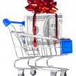 Gift box made of dollars in shopping cart — Stock Photo