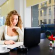 Stock Photo: Woman is working on laptop