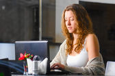Woman is working on laptop — Stock Photo
