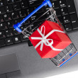 Gift on a laptop keyboard — Stock Photo #8541187