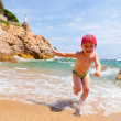 Playing on a sea coast — Stock Photo #8585426