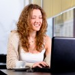Young woman is working on laptop — Stock Photo