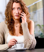 Young woman is talking phone — Stock Photo