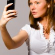 Woman is taking picture of herself — Stock Photo