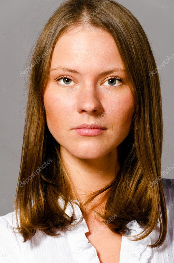 Beautiful young caucasian woman on gray background — Stock Photo #9349261
