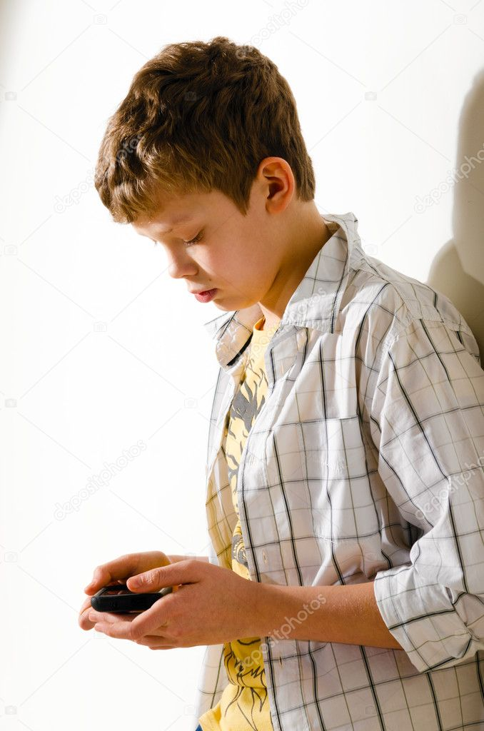 Teenager boy is using phone at school — Stock Photo #9472295