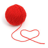 Red yarn with heart symbol — Stock Photo