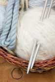 Knitting needles and skein of wool — Stock Photo