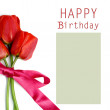 Three red tulips on a greeting card — Stock Photo