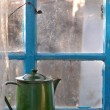 Old teapot on a window sill — Stock Photo #8565071