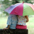 Постер, плакат: Children under umbrella