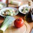 A bottle of olive oil and vegetables — ストック写真