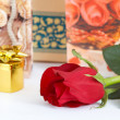 Rose and jewelry — Stock Photo #8565926
