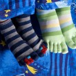 Two pairs of feet in socks — Stock Photo