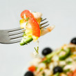 Fork with fresh salad - Stock Photo