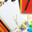 Stock Photo: Notepad with stationary objects