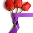 Red tulips with ribbon — Stock Photo