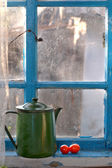 Old teapot on a window sill — Stock Photo