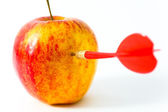 Red apple with red dart — Stock Photo