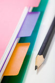 Notebook and black pencil — Stock Photo