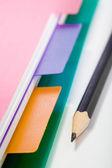 Notebook en zwart potlood — Stockfoto