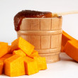 Honey and slice of pumpkin - Stock Photo