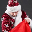 Christmass-bag and Santa — Stock Photo #8577647