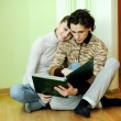 Couple looking in album — Stock Photo #8578409