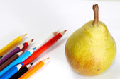 Pencils-set and yellow pear — Stock Photo