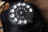 An image of black retro telephone in the studio. — Stock Photo