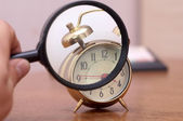 Magnifier and clock — Stock Photo