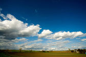 Plowed field and cloudy sky — Stock Photo