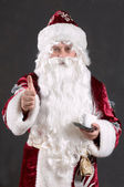 Santa claus showing thumb — Stock Photo