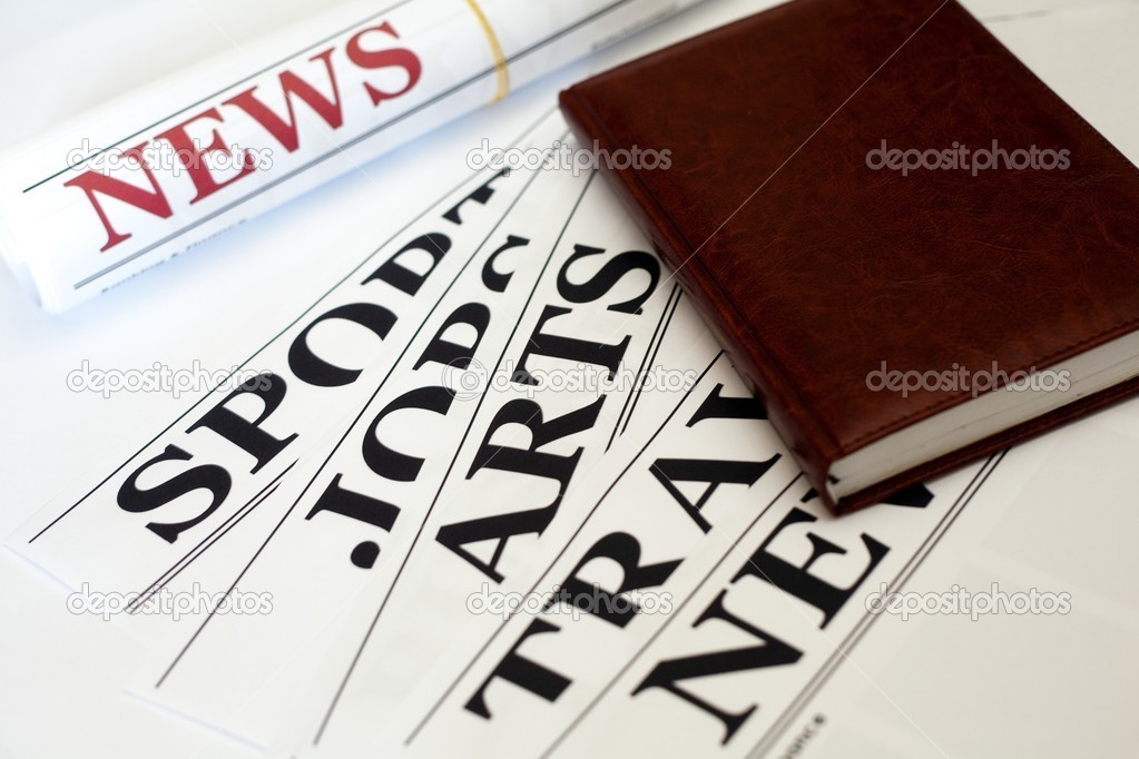 An image of a notebook and a newspaper — Stock Photo #8571091