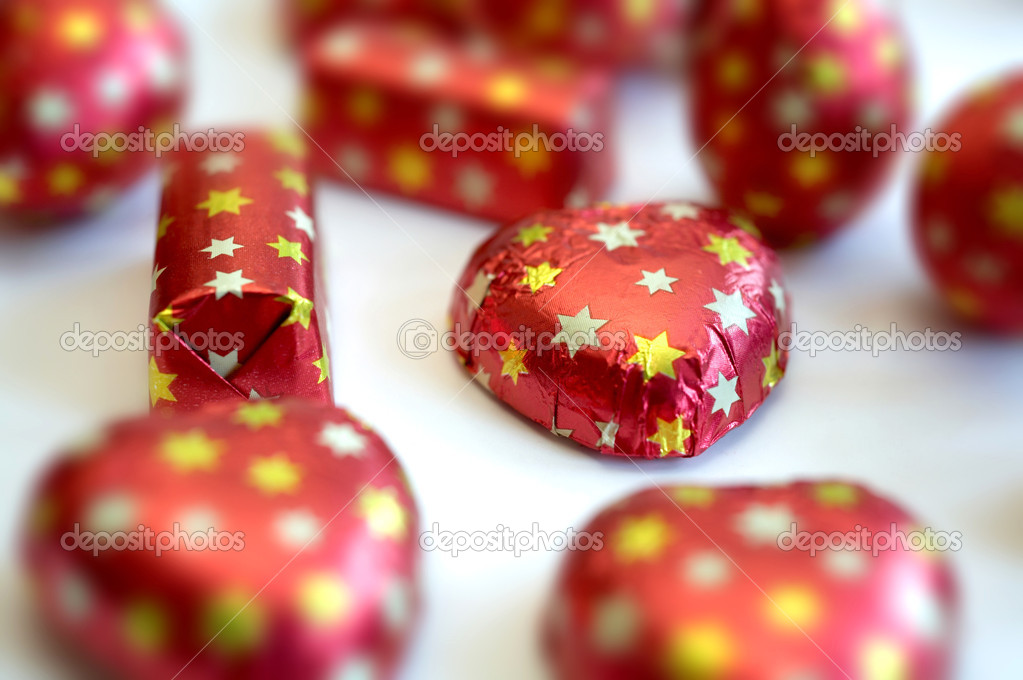 An image of sweetmeats in red wraping — Stock Photo #8576421