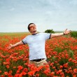 Young man in a field — Stock Photo